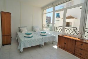 Apartment Vinamar La Mata tesisinde bir odada yatak veya yataklar