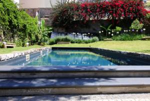 The swimming pool at or near Quinta Araucaria Funchal
