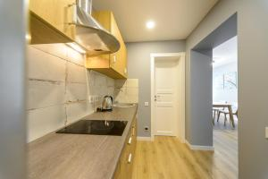 A kitchen or kitchenette at Partner Guest House