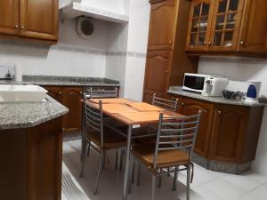 A kitchen or kitchenette at Casa da Guida