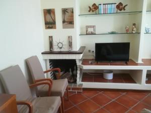 A television and/or entertainment center at Vila Cha Apartment