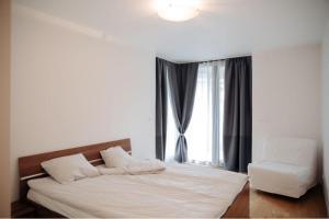 Кровать или кровати в номере Central Park Apartments Prague3