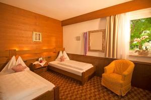 Ein Bett oder Betten in einem Zimmer der Unterkunft Alpina Residence