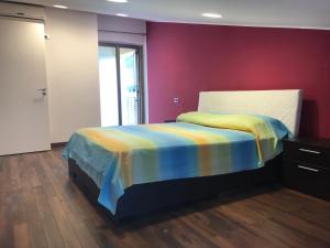 Ліжко або ліжка в номері Mansarda a pochi passi dal mare