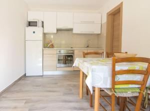 A kitchen or kitchenette at Apartments Nicole