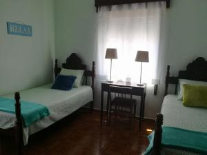 A bed or beds in a room at Casa da Praia - Group Accommodation