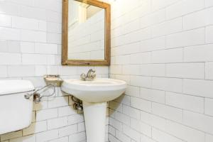 A bathroom at Boutique room in The Mall, Manali, by GuestHouser 10877