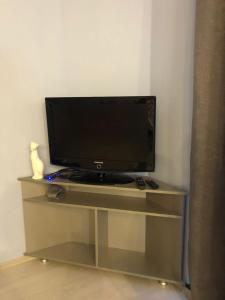 A television and/or entertainment center at Aquamarine Apartment