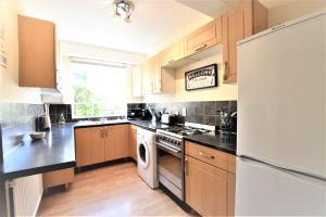 Küche/Küchenzeile in der Unterkunft Greystone Avenue - yourapartment