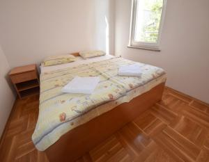 A bed or beds in a room at Apartments Horvat