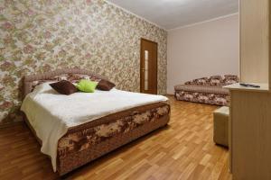 Кровать или кровати в номере Апартаменты на К. Маркса