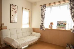 A seating area at Apartment in Kyoto 3060