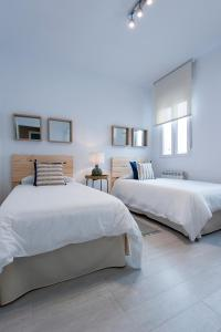A bed or beds in a room at Alterhome Retiro III
