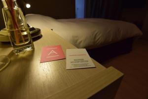Llit o llits en una habitació de Arahova Pansion