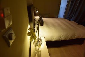 Uma cama ou camas num quarto em Arahova Pansion
