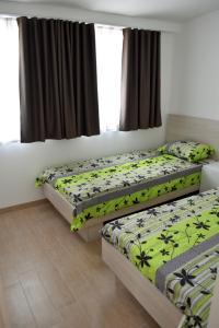 Postelja oz. postelje v sobi nastanitve Apartments Hiša na Placi