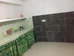 A kitchen or kitchenette at villa eleven