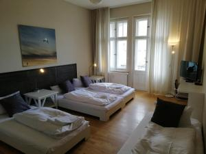 A bed or beds in a room at Holiday Apartments Old Fashioned Architecture in Trendy District Prenzlauer Berg