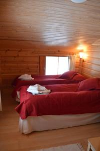 A bed or beds in a room at Holiday Village Himmerki