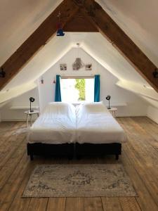 Un ou plusieurs lits dans un hébergement de l'établissement Hogezoom 133