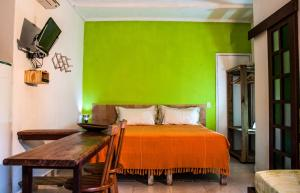 A bed or beds in a room at Casa Verde Apart