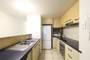 A kitchen or kitchenette at Caloundra Central Apartment Hotel