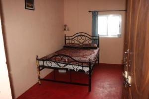 A bed or beds in a room at Garawa resort