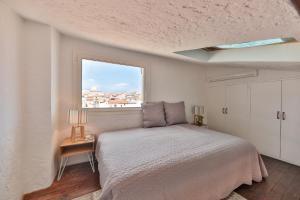 Un ou plusieurs lits dans un hébergement de l'établissement Les toits du vieil Antibes