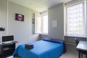 Un ou plusieurs lits dans un hébergement de l'établissement Résidence Carpe Diem