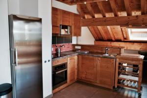 A kitchen or kitchenette at Chalet Arvina