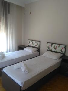 A bed or beds in a room at Olena House