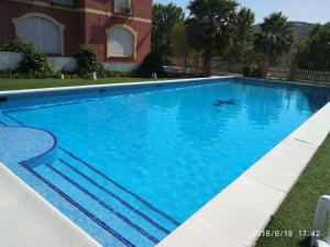 The swimming pool at or near Apartamentos Fuente de la Salud