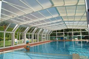 The swimming pool at or near Queen Villa