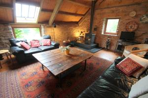 A seating area at Bentwitchen Barn Cottage