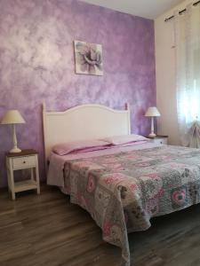 A bed or beds in a room at Casa Vacanze Milvia