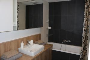 Łazienka w obiekcie Komfort Apartments Alte Donau/Donauzentrum