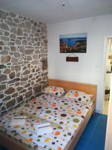 A bed or beds in a room at Holiday House Popovic