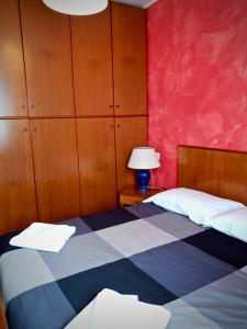 A bed or beds in a room at Roggiana Apartment