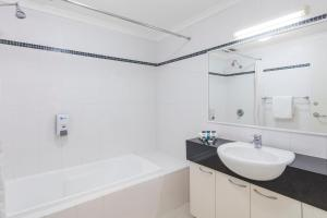 A bathroom at Mounts Bay Waters Apartment Hotel