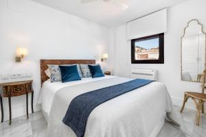 A bed or beds in a room at iloftmalaga Miramar