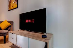 A television and/or entertainment center at Ari Apartments - Wembley Stadium
