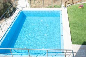 The swimming pool at or near Villa Amfimala