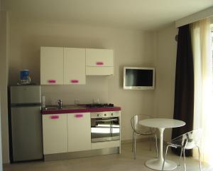 A kitchen or kitchenette at La Fattoria Apartments