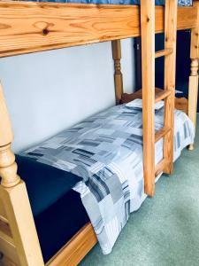 A bunk bed or bunk beds in a room at Lugano lake's luxury residence
