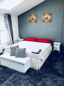 A bed or beds in a room at Lugano lake's luxury residence