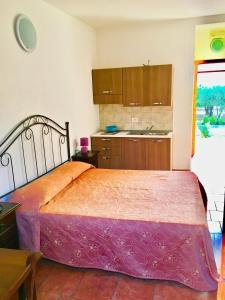 Cucina o angolo cottura di Case Vacanza La Giara