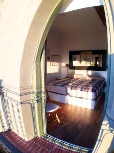 A bed or beds in a room at Barceloneta Port Ramblas