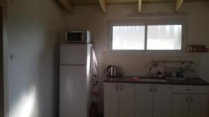 Küche/Küchenzeile in der Unterkunft A Place To Remember