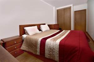 A bed or beds in a room at Apartamento Bisengototo