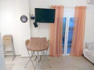 A television and/or entertainment center at Mary's Maisonette